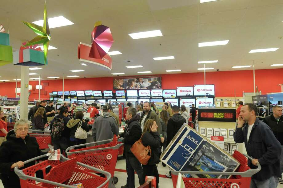 Shoppers scurry about the electronics department at the Target store on Thursday evening, Nov. 22, 2012 in Colonie, NY.  The store opened at 9pm on Thursday evening, giving shoppers an early start on black friday shopping.  (Paul Buckowski / Times Union) Photo: Paul Buckowski