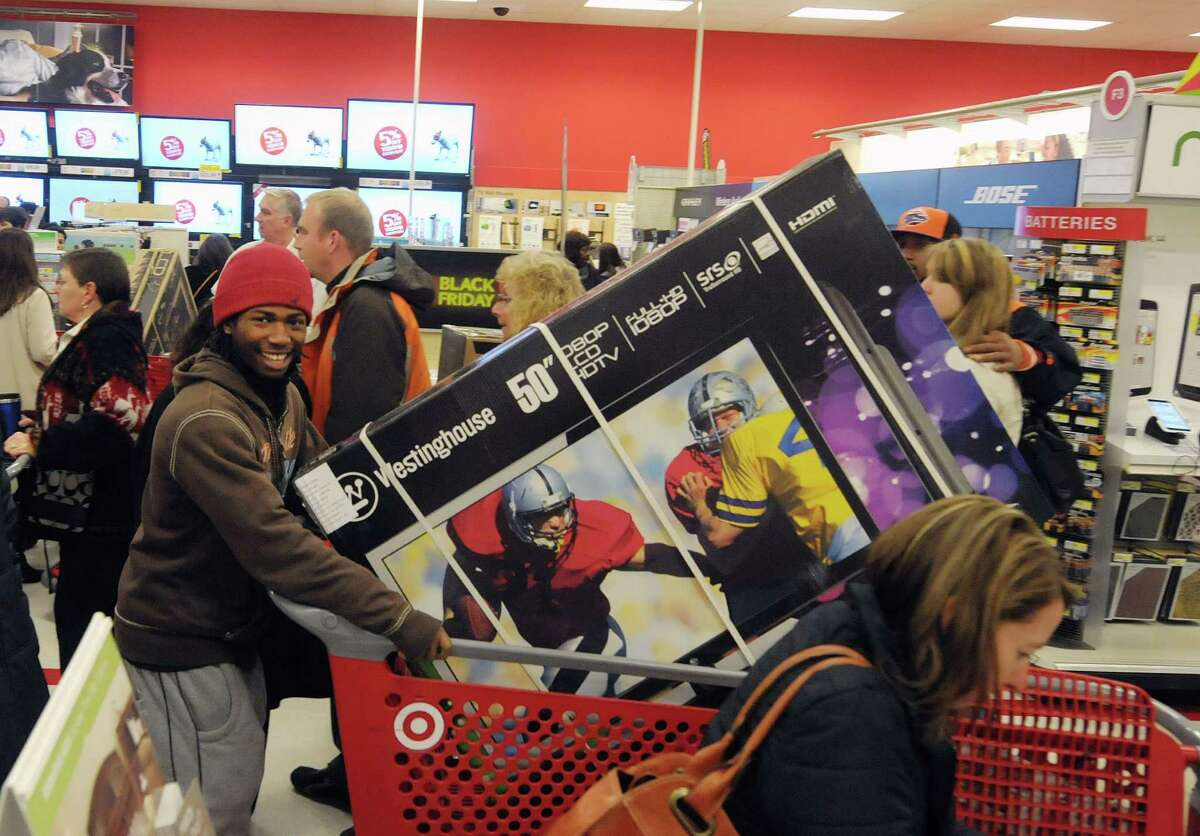 Kwamel Bryant pushes a cart with the 50-inch television he waited in line to get at Target on Thursday evening, Nov. 22, 2012, in Colonie, N.Y. The store opened at 9 p.m., giving shoppers an early start on Black Friday shopping. (Paul Buckowski / Times Union)