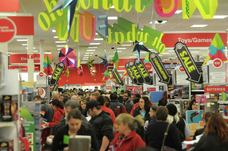 Shoppers make their way through the Target store on Thursday evening, Nov. 22, 2012 in Colonie, NY.  The store opened at 9pm on Thursday evening, giving shoppers an early start on black friday shopping.  (Paul Buckowski / Times Union) Photo: Paul Buckowski