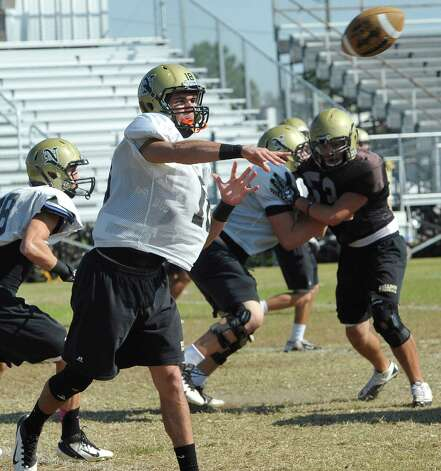 The Nederland High School football team was practicing on Tuesday morning. Quarterback Carson Raines,#18 was guiding the offense. Nederland's offense has developed throughout the season and has become a balanced unit heading into Friday's second round playoff game against Pflugerville Connally. Dave Ryan/The Enterprise Photo: Dave Ryan