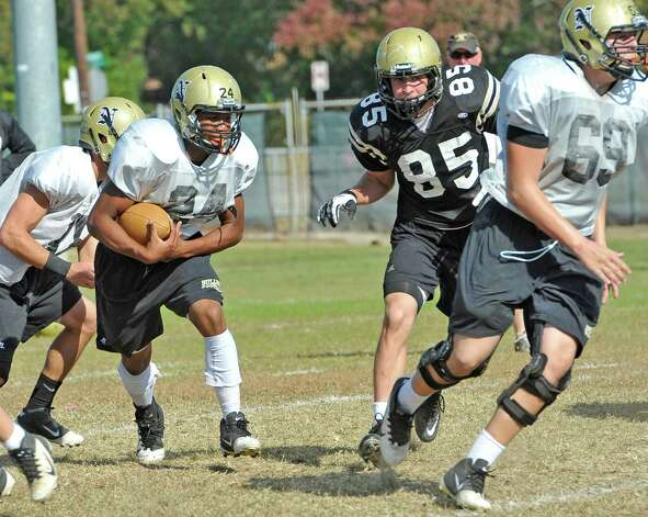The Nederland High School football team was practicing on Tuesday morning. Running back #24, Kendrick Hopkins, left, is part of the Nederland offense which has developed throughout the season and has become a balanced unit heading into Friday's second round playoff game against Pflugerville Connally. Dave Ryan/The Enterprise Photo: Dave Ryan