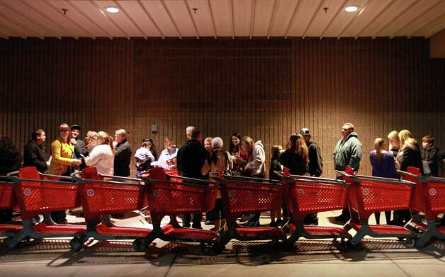 "A line forms in front of Target as they wait before its opening at 9 p.m. as shoppers took advantage of the sales and deals in the earlier shopping period for the typical ""Black Friday"" event on Thursday evening, Nov. 22, 2012 in Chico, Calif. Photo: Jason Halley, Chico Enterprise-Record"