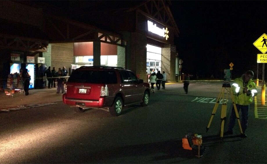 The 71-year-old driver of this Mercury SUV was arrested for investigation of vehicular assault after her hit a man and woman Thursday night in a Wal-Mart parking lot. The collision happened at 17432 S.E. 270th Pl. in Covington, about 25 miles south of downtown Seattle. A Sheriff's spokeswoman said both the victims and suspect were going for Black Friday deals. (KCSO)
