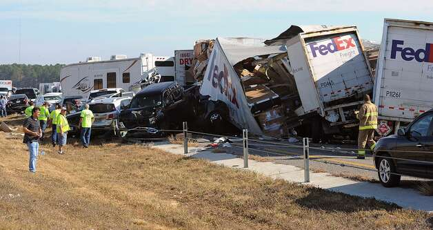 Cars and Trucks are piled on Interstate 10 in Southeast Texas Thursday Nov. 22, 2012.  The Texas Department of Public Safety says at least 35 people have been injured in a more than 50-vehicle pileup.    (AP Photo/The Beaumont Enterprise, Guiseppe Barranco) Mandatory Credit Photo: Guiseppe Barranco