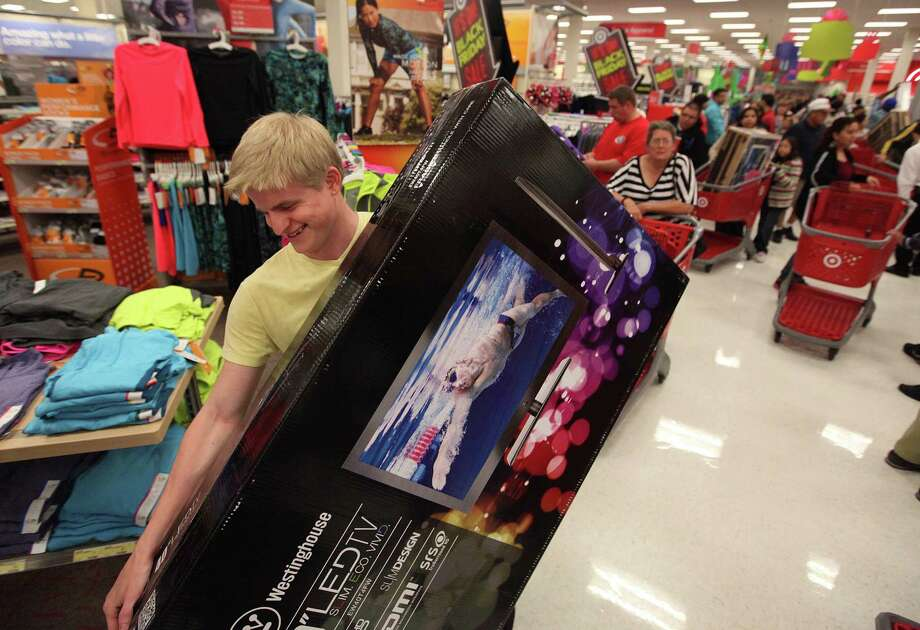 Joshua Dooley smiles after getting his flat screen TV at Target as he takes advantage of early Black Friday deals on Thursday, Nov. 22, 2012, in Houston. Photo: Mayra Beltran, Houston Chronicle / © 2012 Houston Chronicle