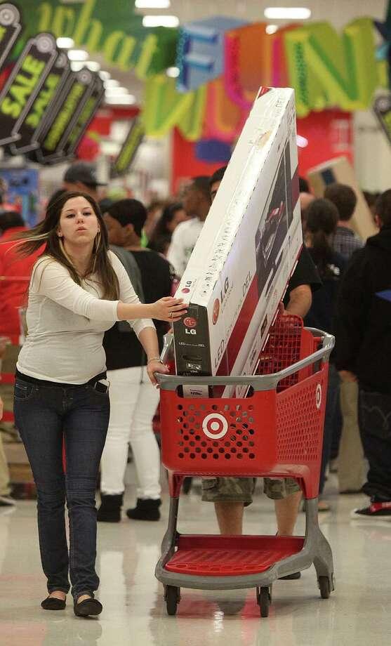 Nila Guerra breaks free from the shopping crowd during Target's Black Friday on Thursday, Nov. 22, 2012, in Houston. Photo: Mayra Beltran, Houston Chronicle / © 2012 Houston Chronicle