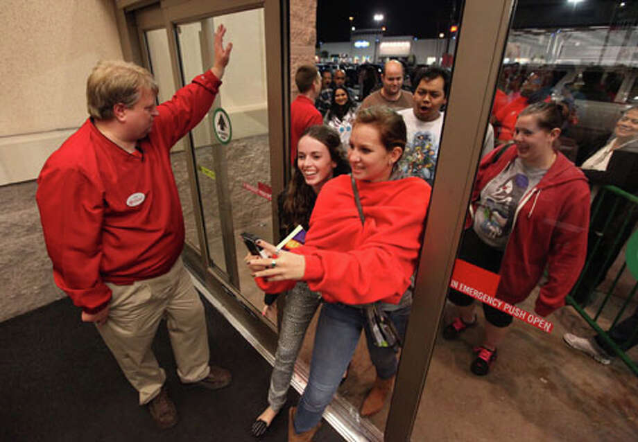 Black Friday shoppers squeeze in through doors shortly after Target opening their doors for Black Friday on Thursday, Nov. 22, 2012, in Houston. Photo: Mayra Beltran, . / © 2012 Houston Chronicle