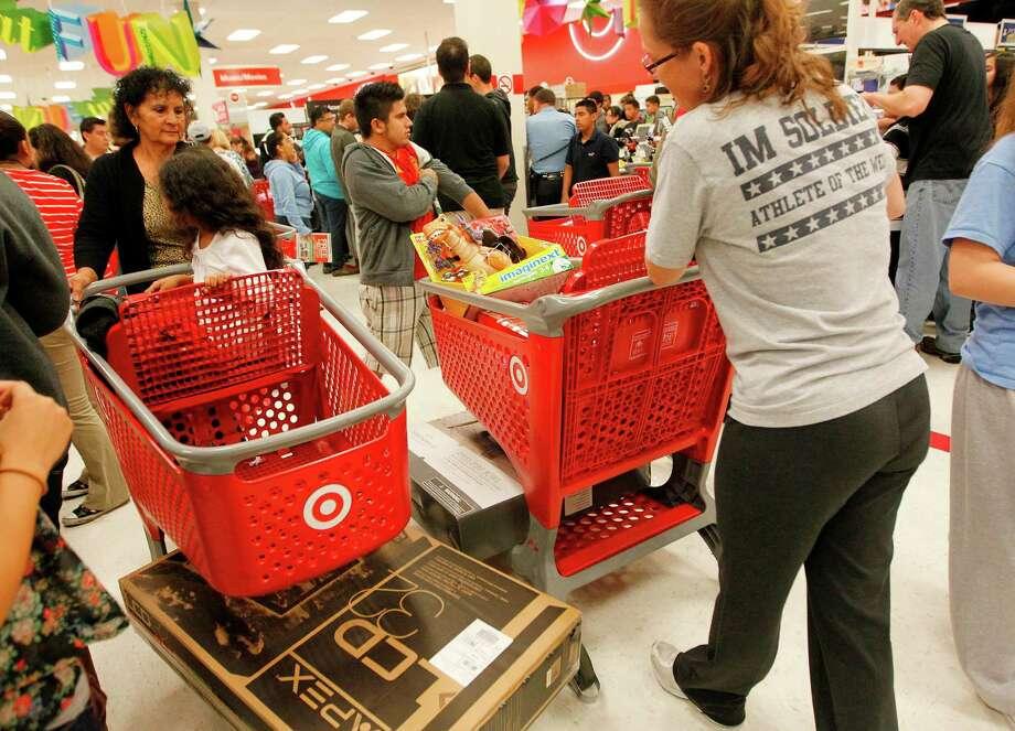 Black Friday begins early for Target shoppers on Thursday, Nov. 22, 2012, in Houston. Photo: Mayra Beltran, Houston Chronicle / © 2012 Houston Chronicle