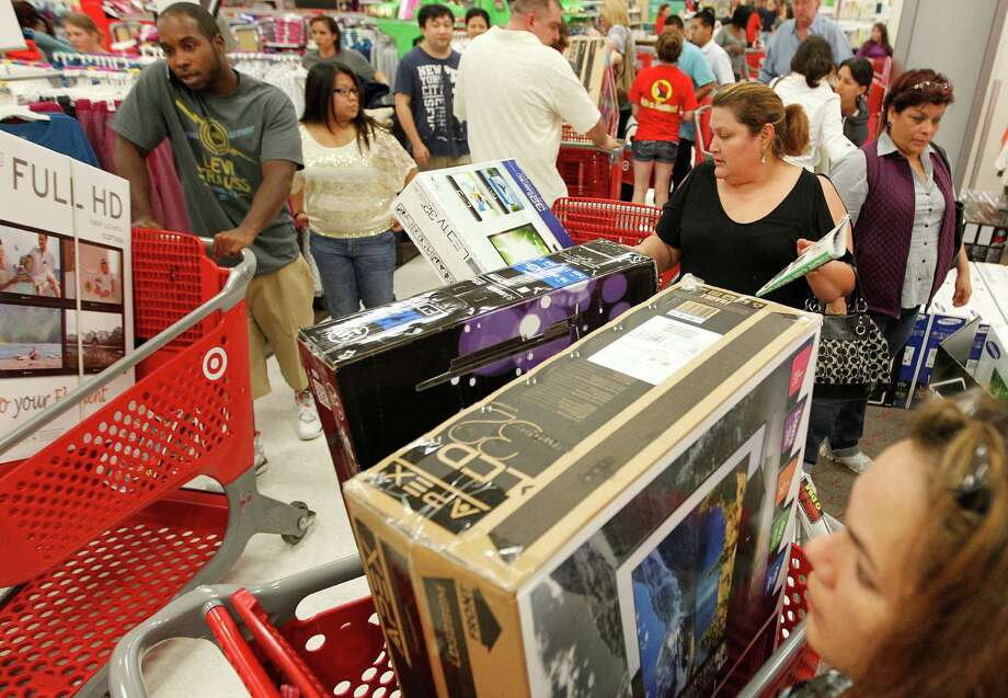 Black Friday begins early for Target shoppers as they grab big ticket items on Thursday, Nov. 22, 2012, in Houston. Photo: Mayra Beltran, Houston Chronicle / © 2012 Houston Chronicle