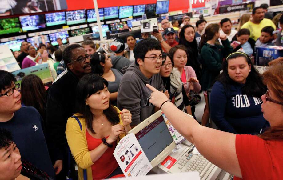 Shoppers congregate around the Electronics kiosk at Target for early Black Friday deals on Thursday, Nov. 22, 2012, in Houston. Photo: Mayra Beltran, Houston Chronicle / © 2012 Houston Chronicle