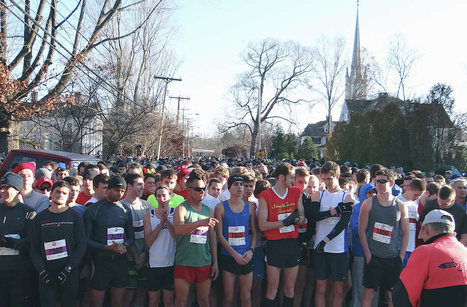 Hundreds of runners, briefed by Jeff Palmer, the race director, mass Thursday at the starting line of the 35th Annual Pequot Turkey Trot on Pequot Avenue.  Fairfield CT 11/22/12 Photo: Mike Lauterborn / Fairfield Citizen contributed