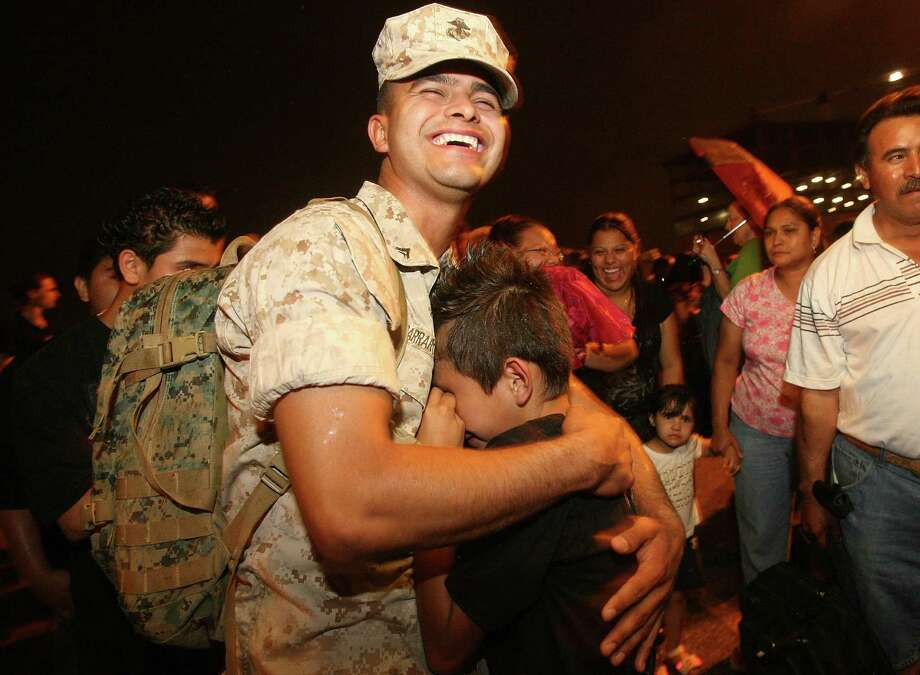 Cpl. Victor Parra, Jr., comforts his baby brother Jonathan Parra who wont stop crying for his brother upon his arrival and of one hundred and forty four Marines from the Houston, TX based 1st Battalion, 23rd Marine Regiment, 4th Marine Division to arrive at the Reserve Center as they return from their seven-month deployment to Al Anbar province, Iraq on Saturday, April 26, 2008 in Houston, TX.  Photo by Mayra Beltran / Chronicle Photo: Mayra Beltran, Houston Chronicle / Houston Chronicle
