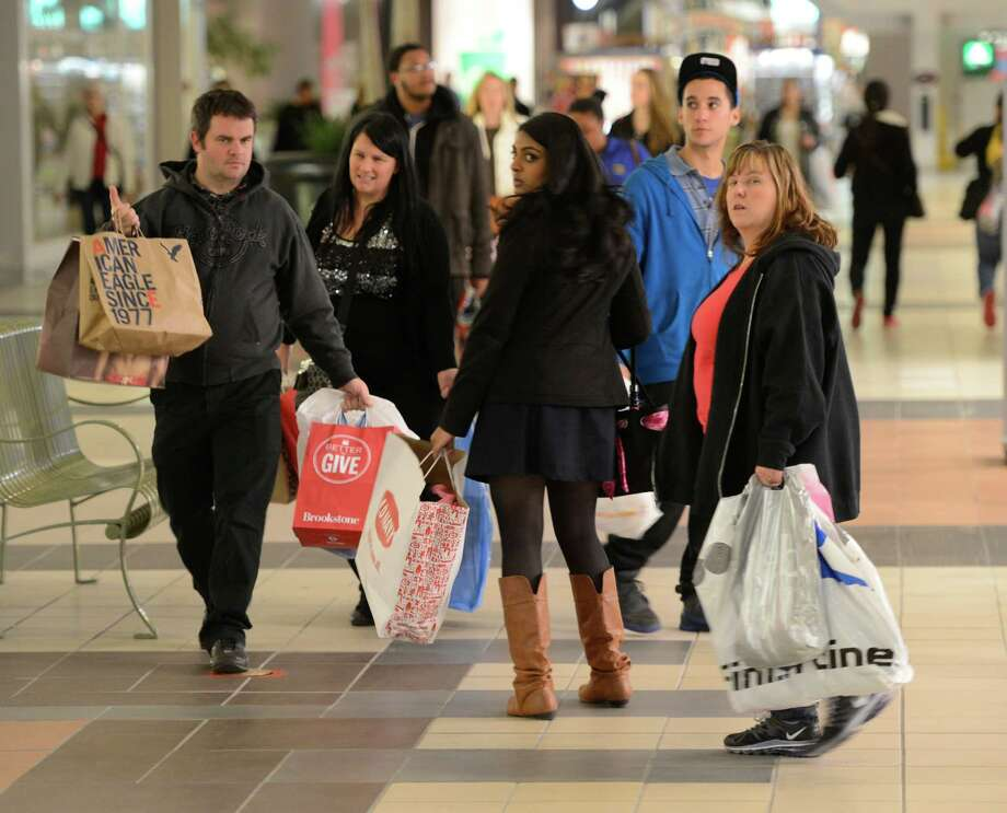Shoppers with hands full of gifts at Crossgates Mall in Guilderland, N.Y. on Black Friday Nov 23, 2012.      (Skip Dickstein/Times Union) Photo: Skip Dickstein, Albany Times Union / 00020194A
