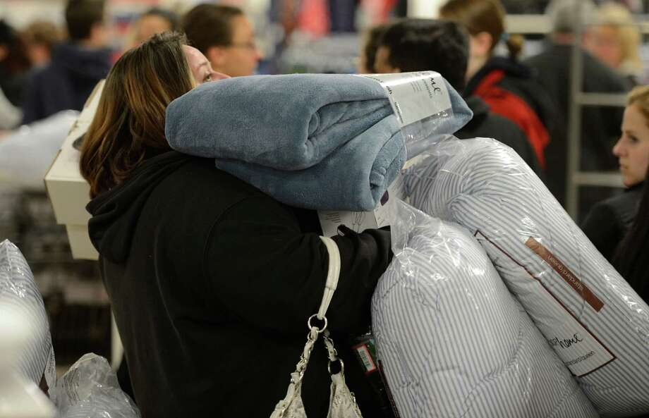 A shopper has her arms full at J. C. Penney at Crossgates Mall in Guilderland, N.Y. on Black Friday Nov 23, 2012.      (Skip Dickstein/Times Union) Photo: Skip Dickstein, Albany Times Union / 00020194A