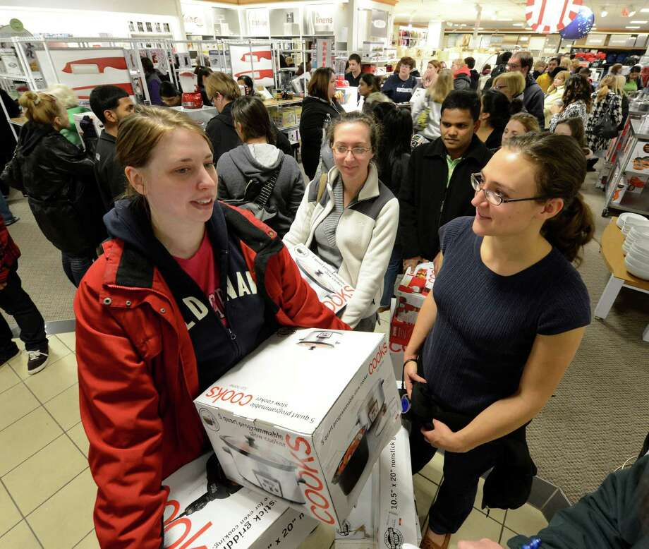 Katie Jacobson, left, Kaitlin Jewell and Sarah Bolognino wait in line at J. C. Penney to cash out at Crossgates Mall in Guilderland, N.Y. on Black Friday Nov 23, 2012.      (Skip Dickstein/Times Union) Photo: Skip Dickstein, Albany Times Union / 00020194A