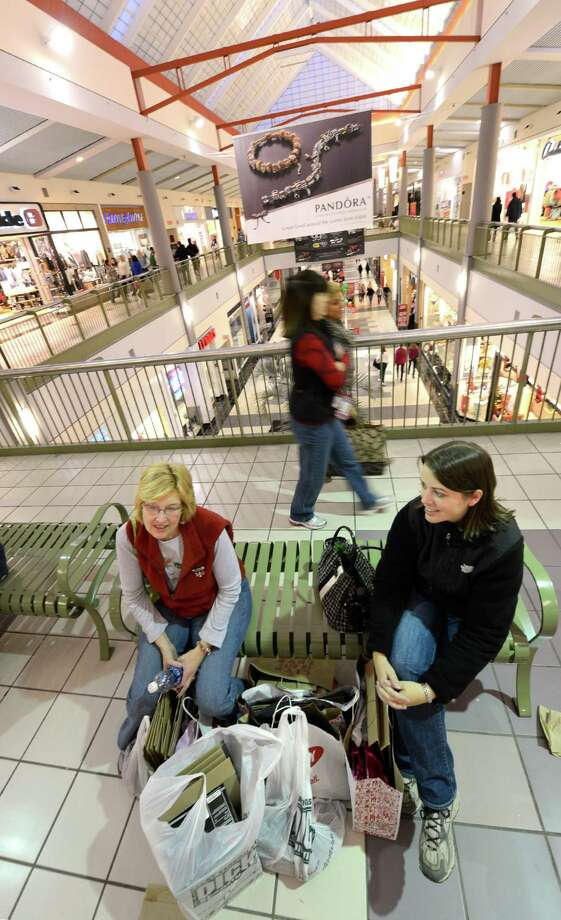Taking a break in the shopping are Linda Jones, left and Lisa Savastana at Crossgates Mall in Guilderland, N.Y. on Black Friday Nov 23, 2012.      (Skip Dickstein/Times Union) Photo: Skip Dickstein, Albany Times Union / 00020194A