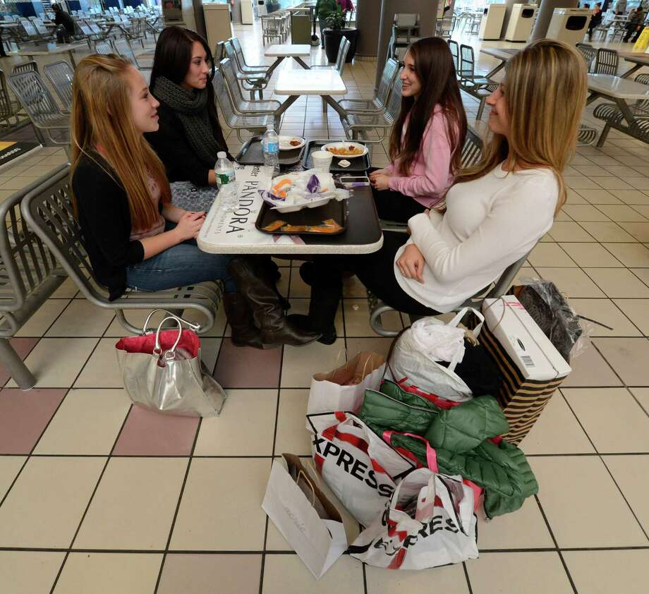 Gabby Renauld, left, Arianna Burton, Jamie Burton and Laurene Burton all of Clifton Park take a break from shopping in the food court at Crossgates Mall in Guilderland, N.Y. on Black Friday Nov 23, 2012.      (Skip Dickstein/Times Union) Photo: Skip Dickstein, Albany Times Union / 00020194A