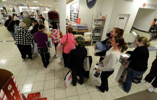 Shoppers wait in line to purchase their gifts at J. C. Penney at 6:00 am at Crossgates Mall in Guilderland, N.Y. on Black Friday Nov 23, 2012.      (Skip Dickstein/Times Union) Photo: Skip Dickstein, Albany Times Union / 00020194A