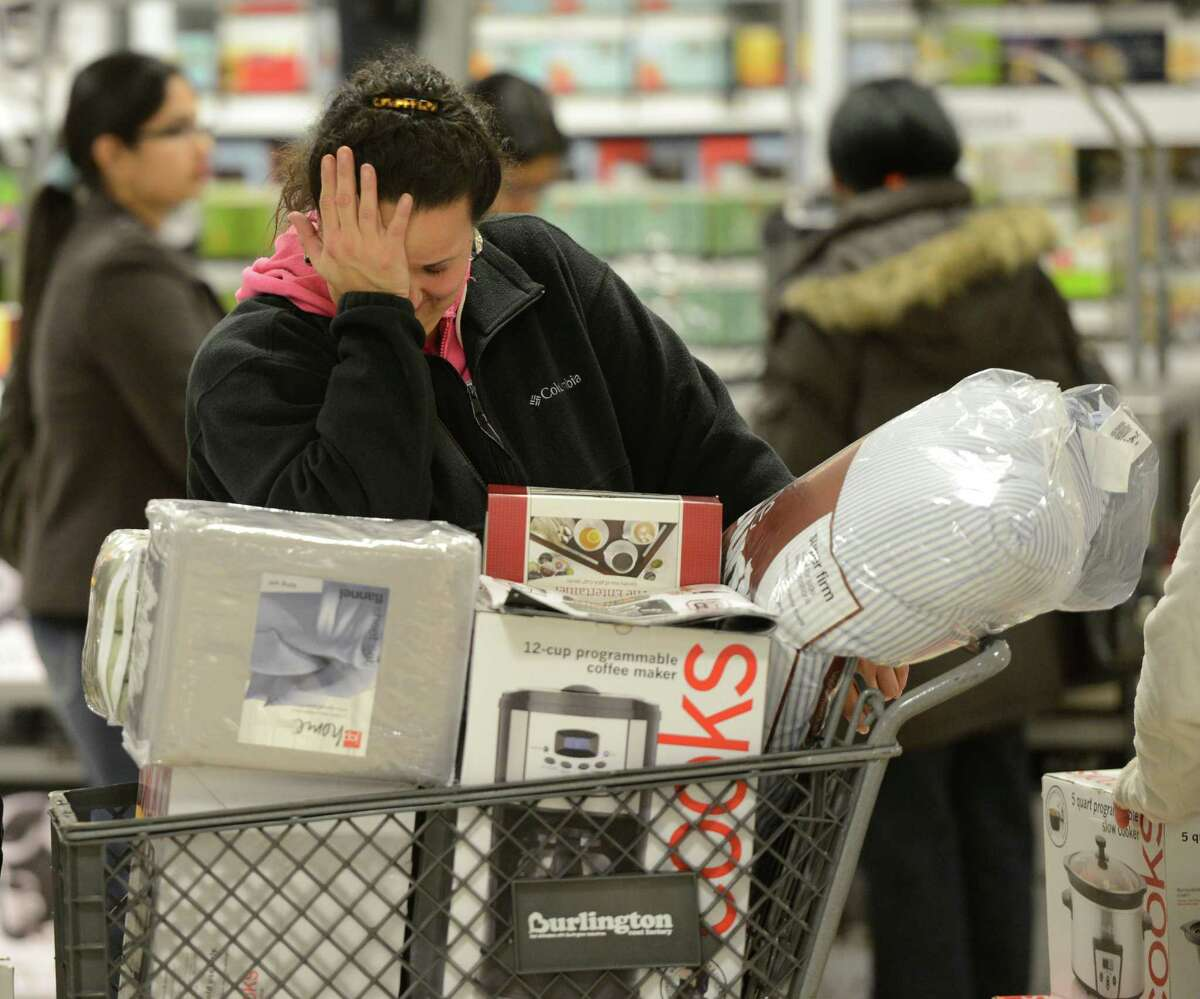 Showing the shopping exhaustion is Diana Roby of Amsterdam at J. C. Penney at 6:00 am at Crossgates Mall in Guilderland, N.Y. on Black Friday Nov 23, 2012. (Skip Dickstein/Times Union)