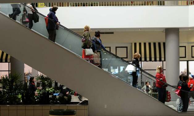 Shoppers ride the escalator at Crossgates Mall in Guilderland, N.Y. on Black Friday Nov 23, 2012.      (Skip Dickstein/Times Union) Photo: Skip Dickstein, Albany Times Union / 00020194A