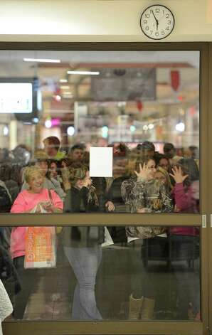 Shoppers wait patiently for the 6:00 am opening of J. C. Penney at Crossgates Mall in Guilderland, N.Y. on Black Friday Nov 23, 2012.      (Skip Dickstein/Times Union) Photo: Skip Dickstein, Albany Times Union / 00020194A