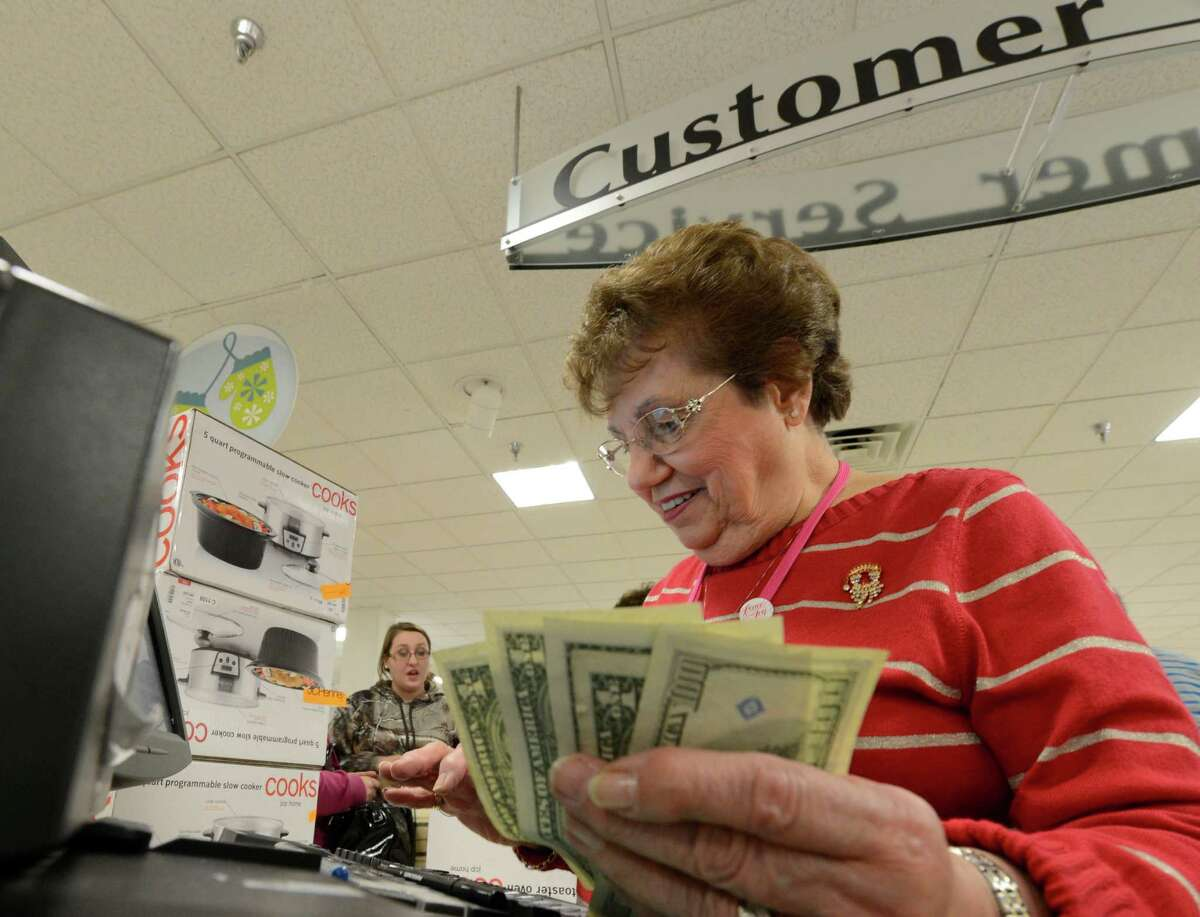Eileen Kenna cashes out a customer Black Friday morning at JCPenney at Crossgates Mall in Guilderland. (Skip Dickstein / Times Union)