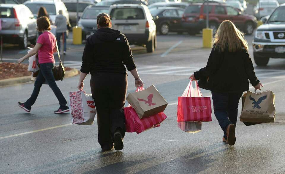 Black Friday shoppers leave Crossgates Mall in Guilderland with their packages. (Skip Dickstein / Ti