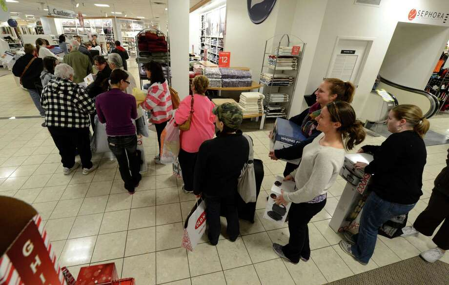 Shoppers wait in the checkout line Black Friday morning at JCPenney at Crossgates Mall in Guilderland. (Skip Dickstein / Times Union) Photo: Skip Dickstein / 00020194A