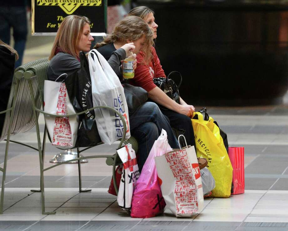 Taking a break from the shopping frenzy are Michelle Watkins, foreground, Kylie Whitaker and Danielle Whitaker at Crossgates Mall in Guilderland, N.Y. on Black Friday Nov 23, 2012.      (Skip Dickstein/Times Union) Photo: Skip Dickstein / 00020194A