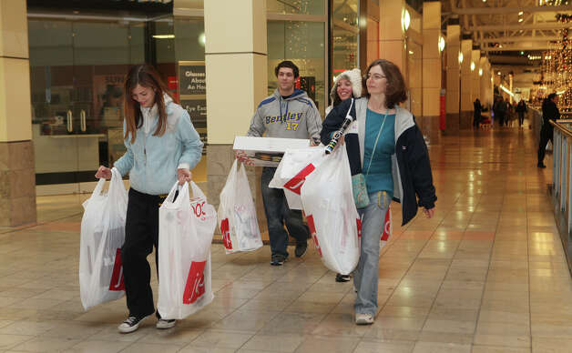 Courtney Tanski, 14, of Milford, leaves the mall with, from left, James Dowers, Jenny Tanski, and Brenda Tanski, at the Westfield CT Post Mall in Milford, Conn. on Friday, November 23, 2012. They started shopping at 4 am. Photo: BK Angeletti, B.K. Angeletti / Connecticut Post freelance B.K. Angeletti