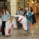 Courtney Tanski, 14, of Milford, leaves the mall with, from left, James Dowers, Jenny Tanski, and Brenda Tanski, at the Westfield CT Post Mall in Milford, Conn. on Friday, November 23, 2012. They started shopping at 4 am.