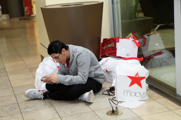 Marco Rodriquez, plays with a new electronic game after shopping with his family at the Westfield CT Post Mall in Milford, Conn. on Friday, November 23, 2012. Photo: BK Angeletti, B.K. Angeletti / Connecticut Post freelance B.K. Angeletti