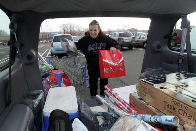 "Nancy Appleton, of West Haven, completes and loads her holiday shopping into her trunk at Walmart in Milford, Conn. on Friday, November 23, 2012.  ""I'm done, I'm done!"" exclaimed Appleton as she loaded her trunk. Photo: BK Angeletti, B.K. Angeletti / Connecticut Post freelance B.K. Angeletti"