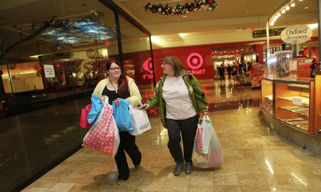 Casey Siconolfi, of Fairfield, and her aunt, Joann Chiodo, of Stratford, shop at the Westfield Connecticut Post Mall in Milford, Conn. on Friday, November 23, 2012. They started shopping at 2 am. Photo: BK Angeletti, B.K. Angeletti / Connecticut Post freelance B.K. Angeletti
