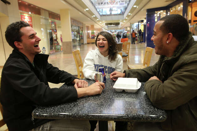 Friends, from left, Paul Stumbo, Jessica O'Connor, and Christian Sobin, drink Red Bulls after shopping at the Westfield Connecticut Post Mall in Milford, Conn. on Friday, November 23, 2012. Photo: BK Angeletti, B.K. Angeletti / Connecticut Post freelance B.K. Angeletti