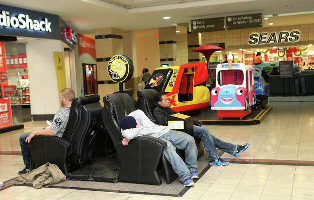 Shoppers rest on the massage chairs at the Westfield Connecticut Post Mall in Milford, Conn. on Friday, November 23, 2012. Photo: BK Angeletti, B.K. Angeletti / Connecticut Post freelance B.K. Angeletti