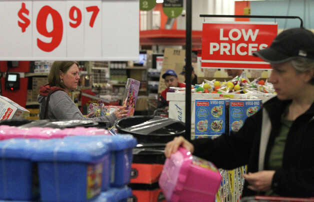 Terri Pulido (left) shops for toys for her kids Black Friday November 23, 2012 at the H-E-B plus! at Loop 1604 and Blanco. Photo: JOHN DAVENPORT, San Antonio Express-News / ©San Antonio Express-News/Photo Can Be Sold to the Public