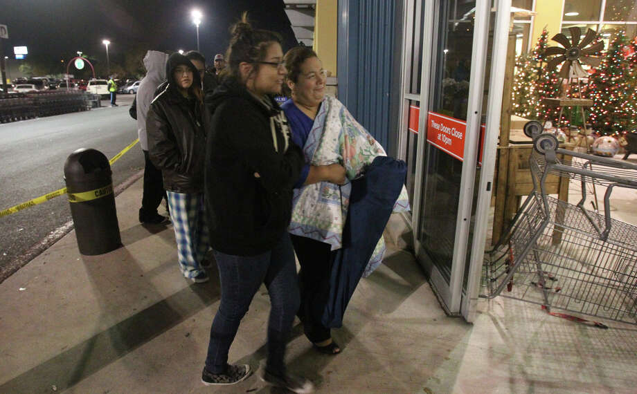 Ana Cruz (right) and her niece Sylvia Reyes (foreground) were the first in line to enter the H-E-B plus! store at 6:00 a.m. Black Friday November 23, 2012. Cruz and Reyes said they had been in line since 11:00 p.m. Thanksgiving night. Photo: JOHN DAVENPORT, San Antonio Express-News / ©San Antonio Express-News/Photo Can Be Sold to the Public