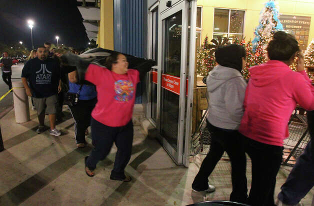 Shoppers in line enter the H-E-B plus! on Loop 1604 near Blanco road at 5:30 a.m. Black Friday November 23, 2012. Popular items on sale at the store are electronic tablets, 16 inch Auria LED televisions and 3DS Nintendos. Toys and appliances were also hot items. Photo: JOHN DAVENPORT, San Antonio Express-News / ©San Antonio Express-News/Photo Can Be Sold to the Public