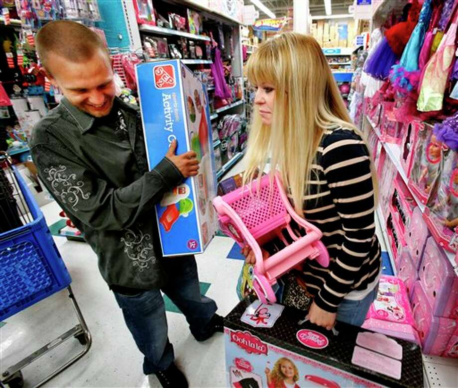 Trevor Fernandez and Brittany Pistole shop at Toys R Us getting a Thanksgiving Day start for Black Friday Sales on Thursday, Nov. 22, 2012, in Norman, Okla. Photo: STEVE SISNEY, AP / THE OKLAHOMAN