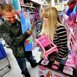 Trevor Fernandez and Brittany Pistole shop at Toys R Us getting a Thanksgiving Day start for Black Friday Sales on Thursday, Nov. 22, 2012, in Norman, Okla.