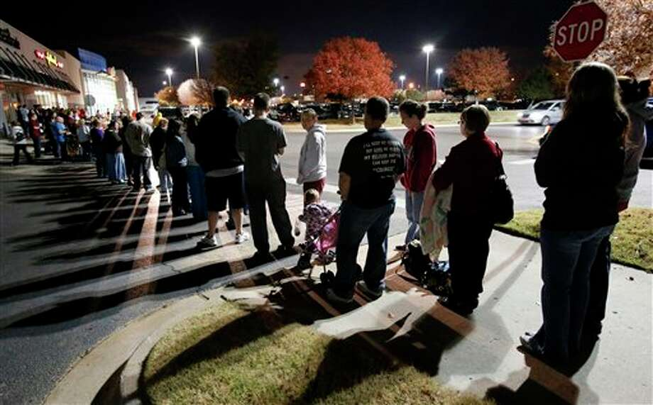 Patrons line up at Toys R Us as they open at 8:00 p.m. on Thanksgiving Day for early Black Friday sales on Thursday, Nov. 22, 2012, in Norman, Okla. Photo: STEVE SISNEY, AP / THE OKLAHOMAN