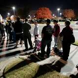 Patrons line up at Toys R Us as they open at 8:00 p.m. on Thanksgiving Day for early Black Friday sales on Thursday, Nov. 22, 2012, in Norman, Okla.