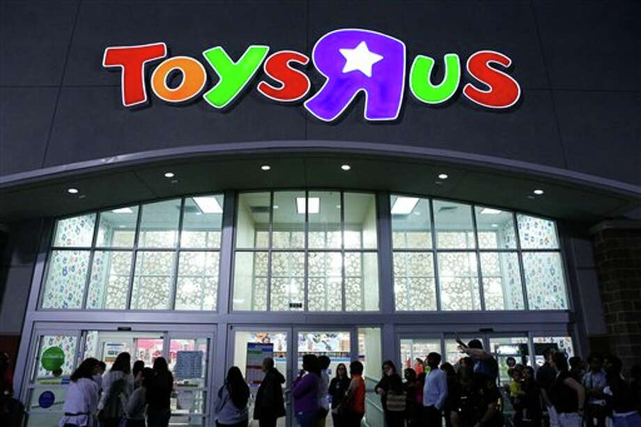 "Shoppers wait in line to take advantage of Black Friday specials at the Toys""R""Us on North Central Expressway in Dallas on Thursday Nov. 22, 2012. Photo: Stan Olszewski, AP / Dallas Morning News"