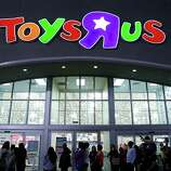"""Shoppers wait in line to take advantage of Black Friday specials at the Toys""""R""""Us on North Central Expressway in Dallas on Thursday Nov. 22, 2012."""
