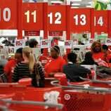Shoppers take advantage of Black Friday specials at the Super Target on Skillman Street in Dallas on Thursday Nov. 22, 2012.