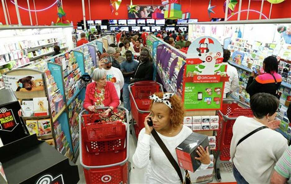 Shoppers form a line in the electronics department to take advantage of Black Friday specials on tel