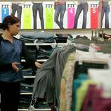Shopper Emily Roberts, from Hawaii uses her phone while looking for clothes sizes at the Target store in Burbank, Calif., on Thursday, Nov. 22, 2012. While stores typically open in the wee hours of the morning on the day after Thanksgiving known as Black Friday, openings have crept earlier and earlier over the past few years. Now, stores from Wal-Mart to Toys R Us are opening their doors on Thanksgiving evening, hoping Americans will be willing to shop soon after they finish their pumpkin pie.