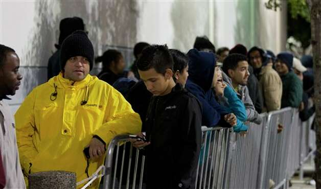 Several thousand shoppers wait in line, some since Wednesday morning, to be the first in the Pembroke Pines, Fla. Best Buy, Thursday, Nov. 22, 2012 for bargains.  Black Friday, traditionally the busiest shopping day of the year, has crept into Thanksgiving Day. A number of stores from Wal-Mart to Target are opening their doors on Turkey Day, but will Americans be willing to put down the pumpkin pie in order to start their holiday shopping a little early. Photo: J Pat Carter, AP / AP2012