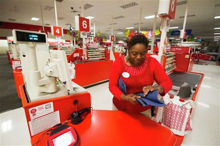 Eva Hopkins, finance supervisor at a Target store in Texarkana, Texas, places money bags in cash reg